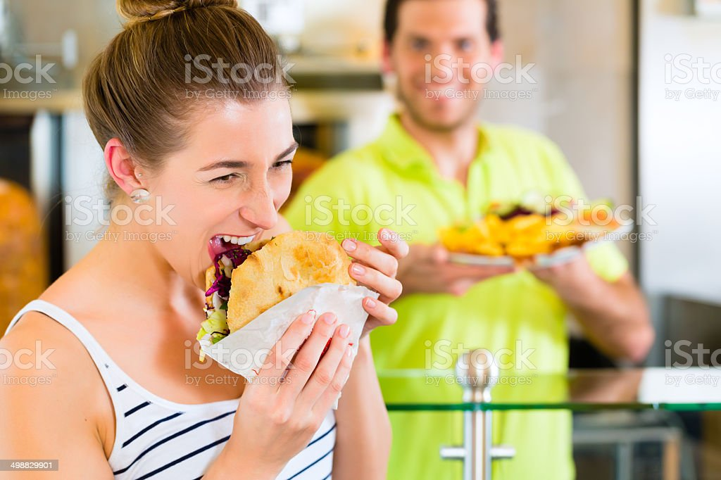 Kebab - customer and hot Doner with fresh ingredients stock photo