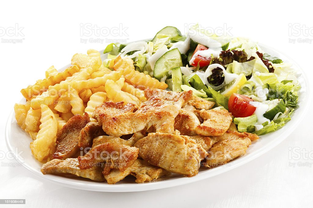 Kebab - grilled meat, chips and vegetables royalty-free stock photo