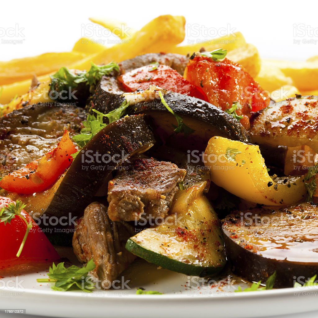 Kebab - grilled meat, French fries and vegetables royalty-free stock photo