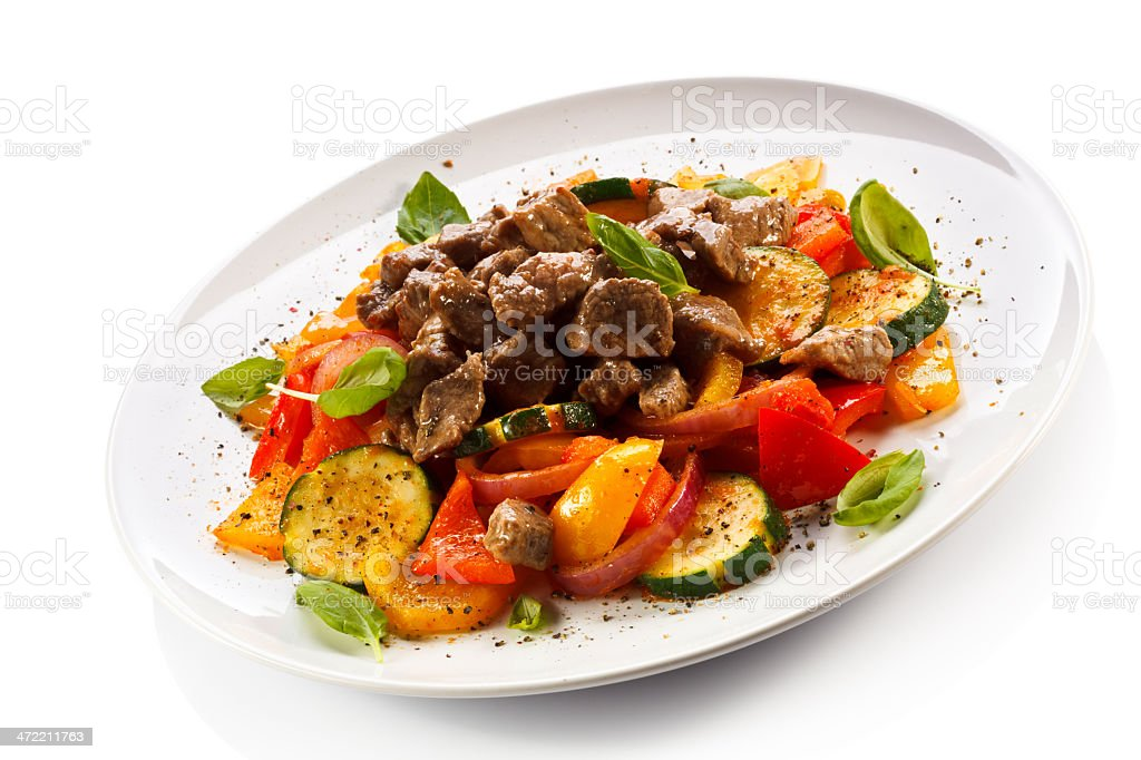 Kebab - grilled meat, French fries and vegetables stock photo