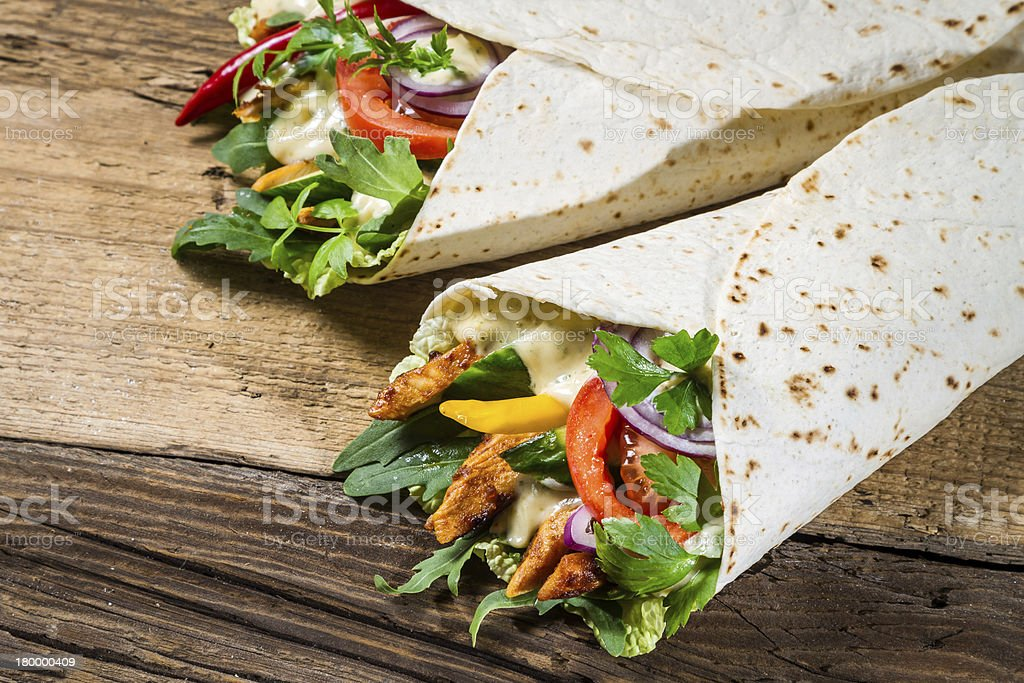 Kebab in a pancake with vegetables and chicken royalty-free stock photo