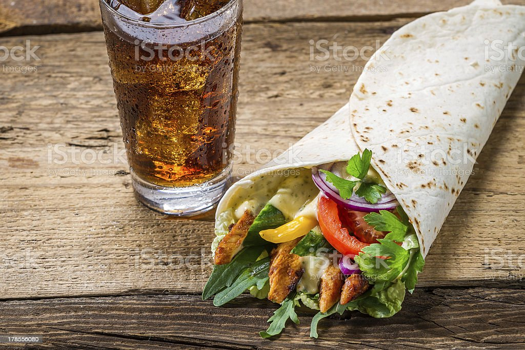 Kebab made of vegetables and chicken served with cold cola royalty-free stock photo