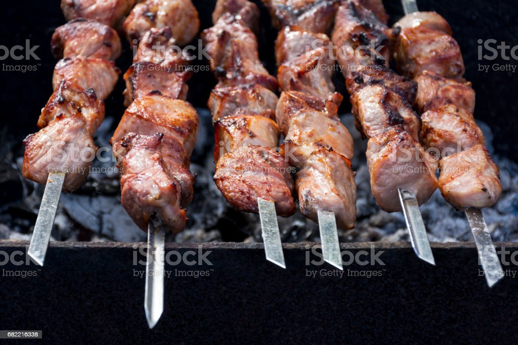 kebab, meat on skewers, fried on coals stock photo