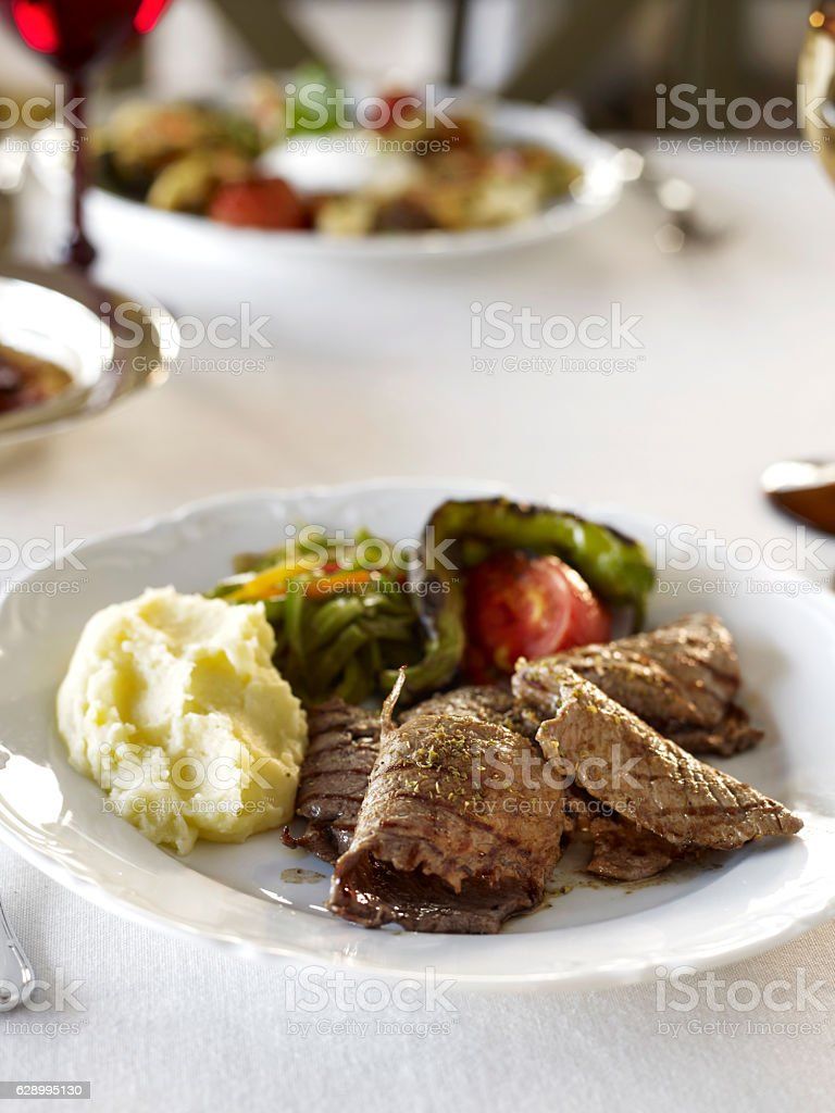 Kebab plate on a chic restaurant table stock photo