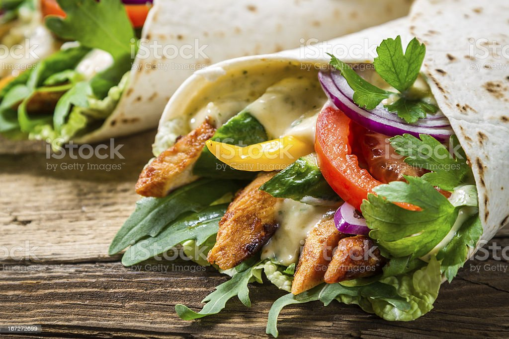 Kebab served with cold beer on old wooden table royalty-free stock photo