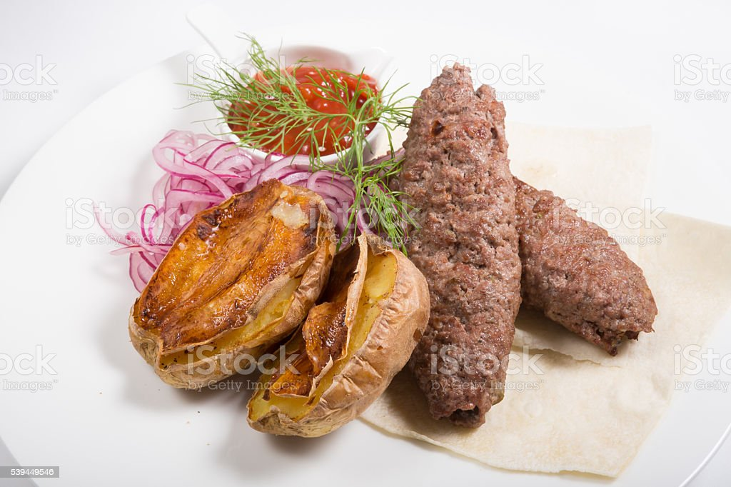 Kebab with potato garnish stock photo