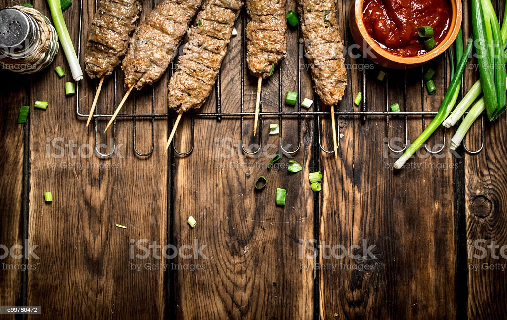 Kebab with tomato sauce and green onions. stock photo