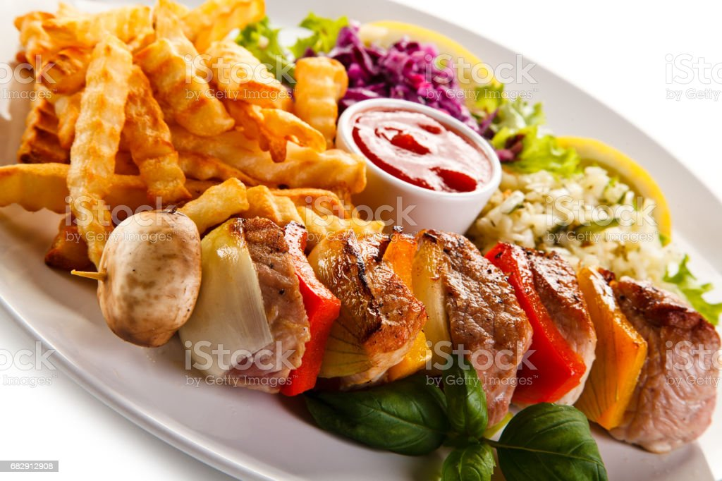 Kebabs - grilled meat and vegetables on white background stock photo