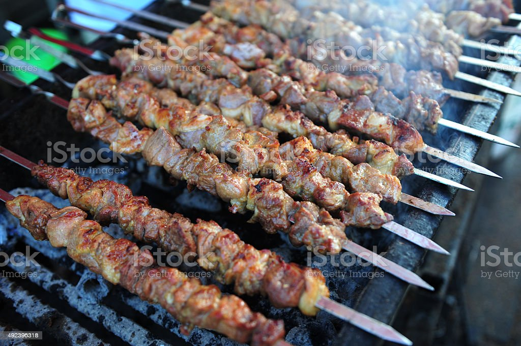 Kebabs on Flaming Grill stock photo
