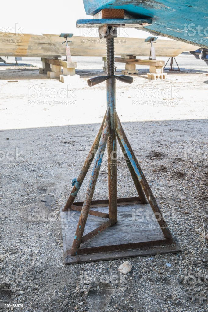 Keel stand holding up boat in dry dock stock photo