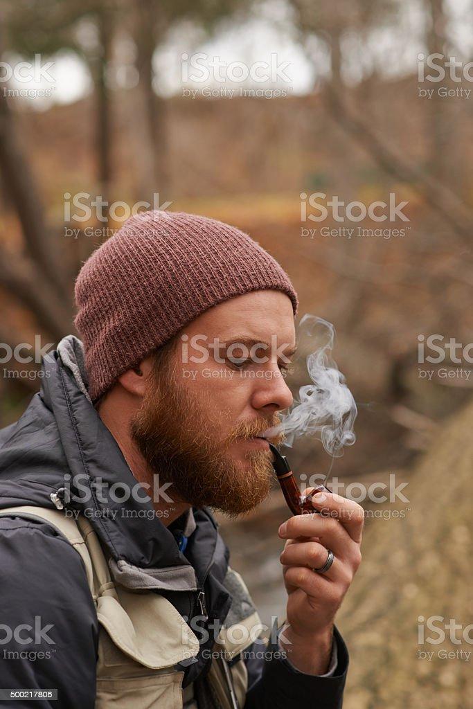 Keep calm and smoke a pipe stock photo
