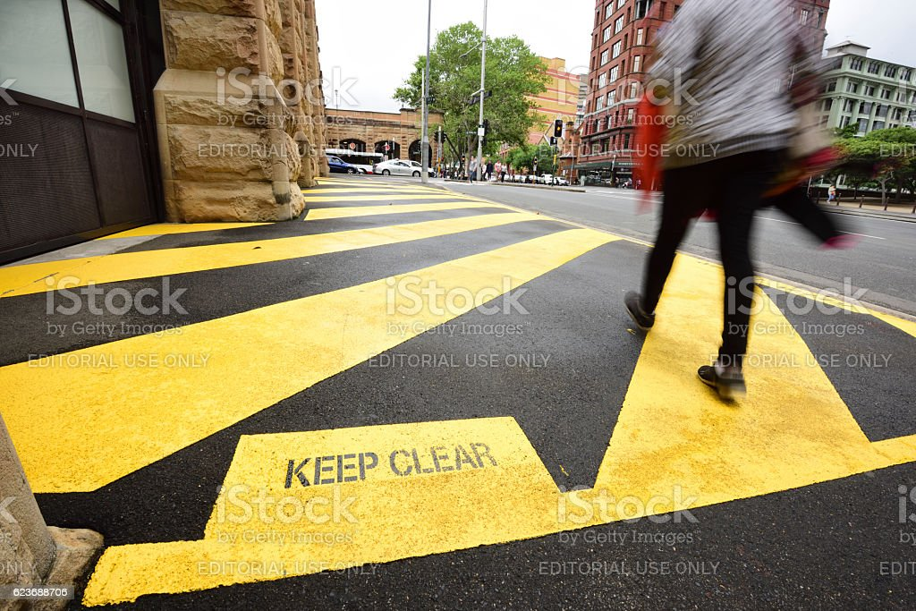 Keep clear painted on ground outside fire station exit stock photo