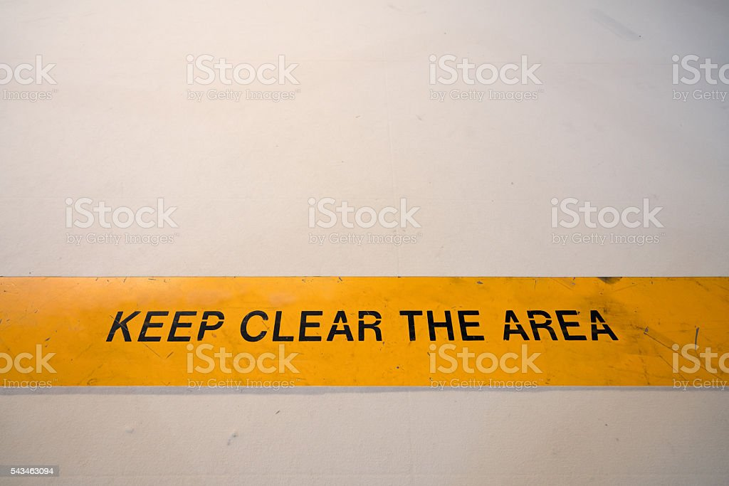 Keep clear warning sign in yellow banner on the floor stock photo