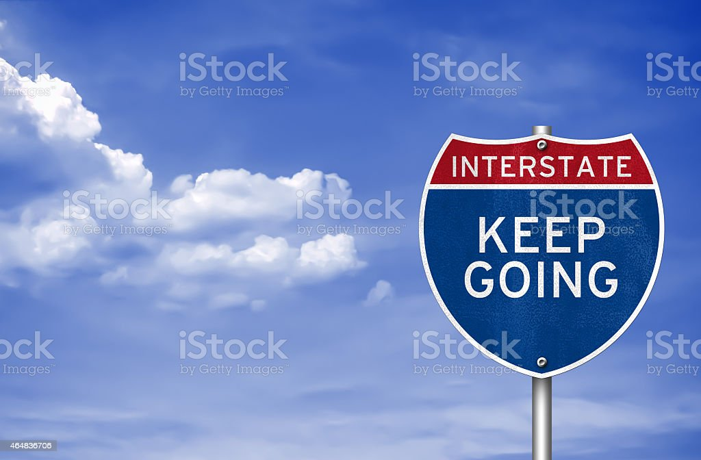 Keep going road sign concept stock photo