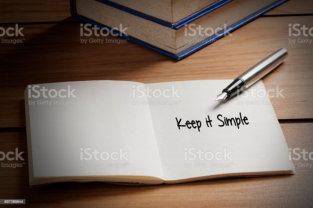 Keep it Simple word on book stock photo