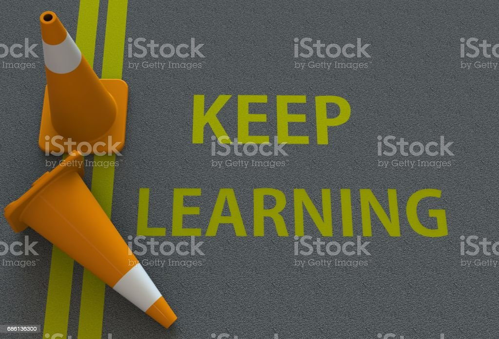 Keep Learning, message on the road stock photo