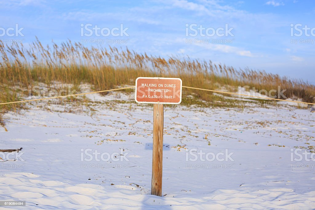 'Keep Off Dunes' sign at Henderson state park beaches highlights stock photo