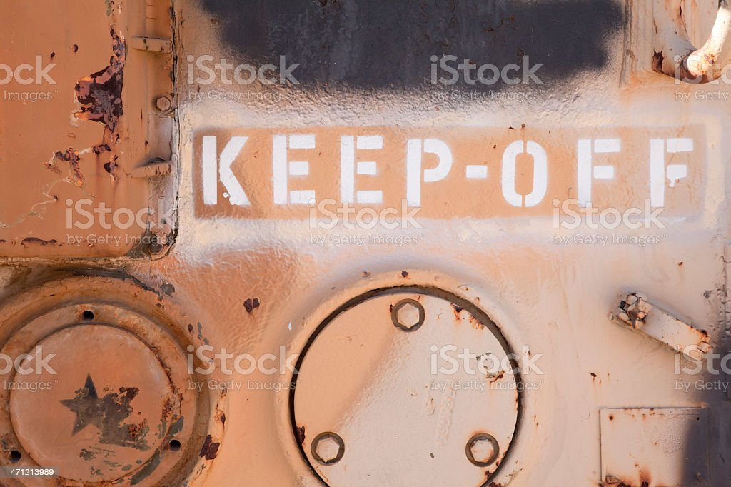 Keep Off Sign Stenciled on Side of Military Vehicle royalty-free stock photo