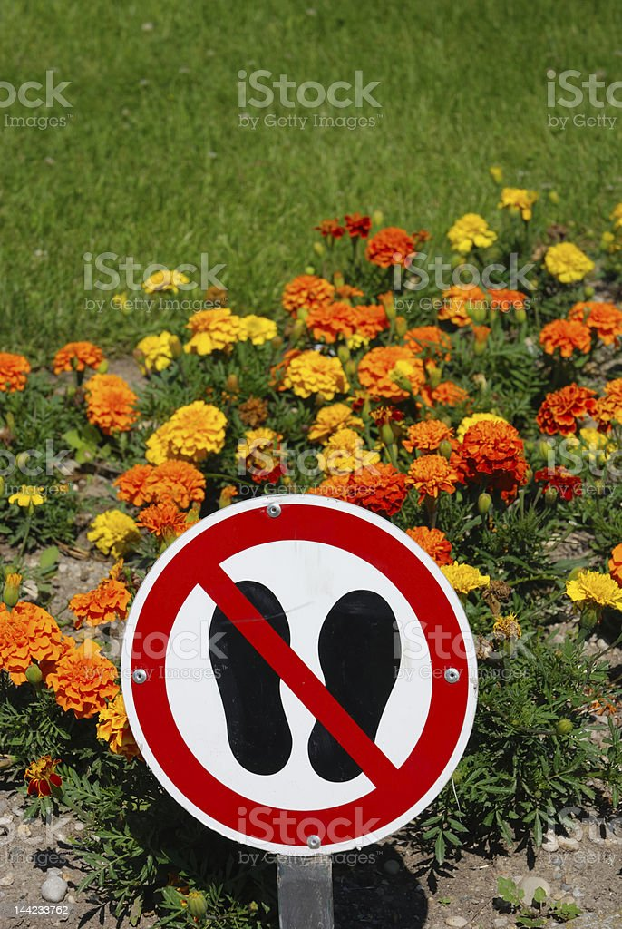 keep off sign with meadow and flowers royalty-free stock photo