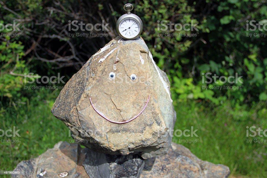 Keep on Smiling Inuksuk Man stock photo