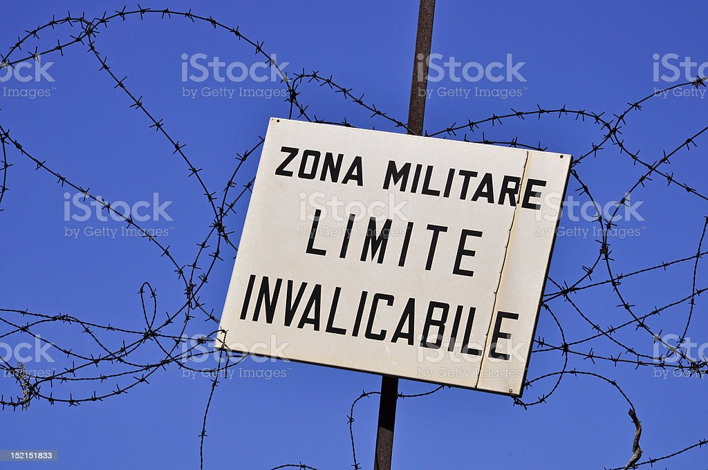 keep out sign of military area against blue sky royalty-free stock photo