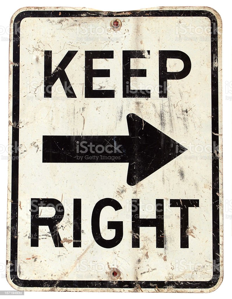 Keep Right road sign, black arrow on dirty white background royalty-free stock photo