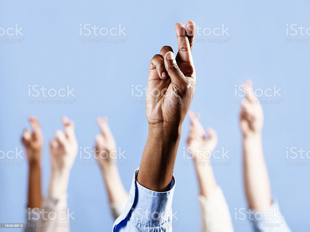 Keep your fingers crossed! Many hands ward off bad luck royalty-free stock photo