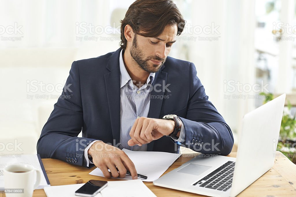 Keeping an eye on the time stock photo