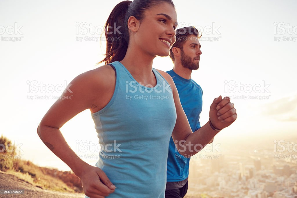 Keeping each other motivated during their run stock photo