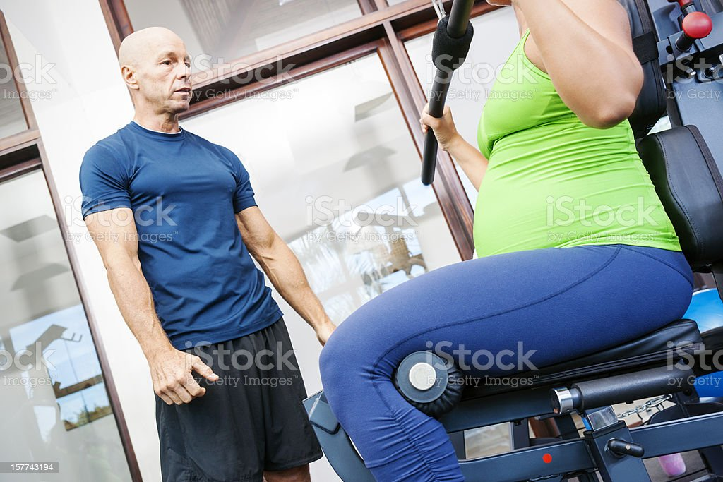 Keeping fit with a personal trainer during pregnancy royalty-free stock photo