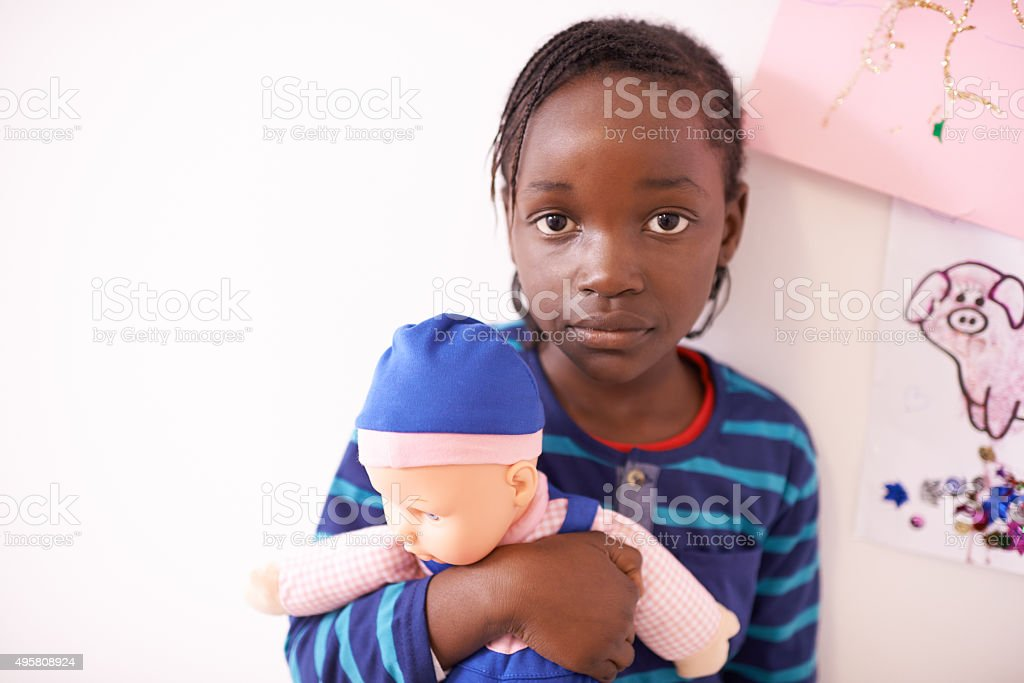 Keeping her doll close stock photo