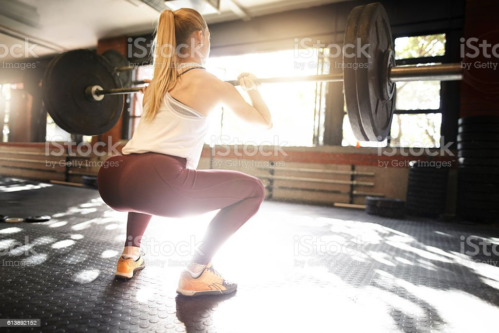 Keeping her glutes tightened and toned stock photo