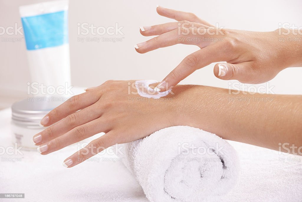 Keeping her hands silky and smooth royalty-free stock photo