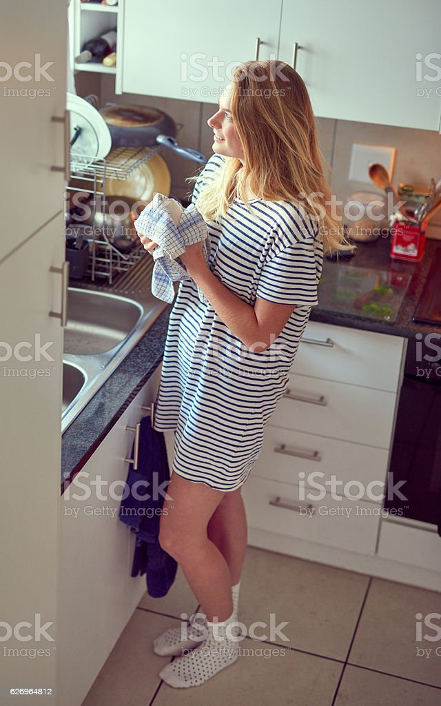 Keeping her kitchen tidy stock photo