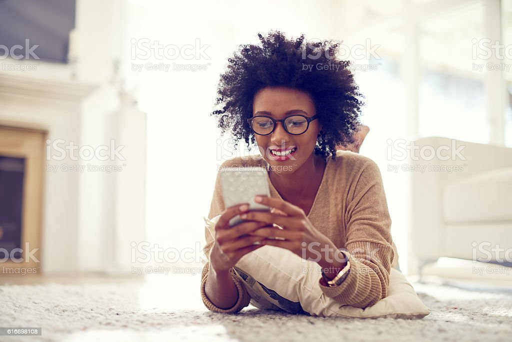 Keeping her phone fresh with some brand new apps stock photo