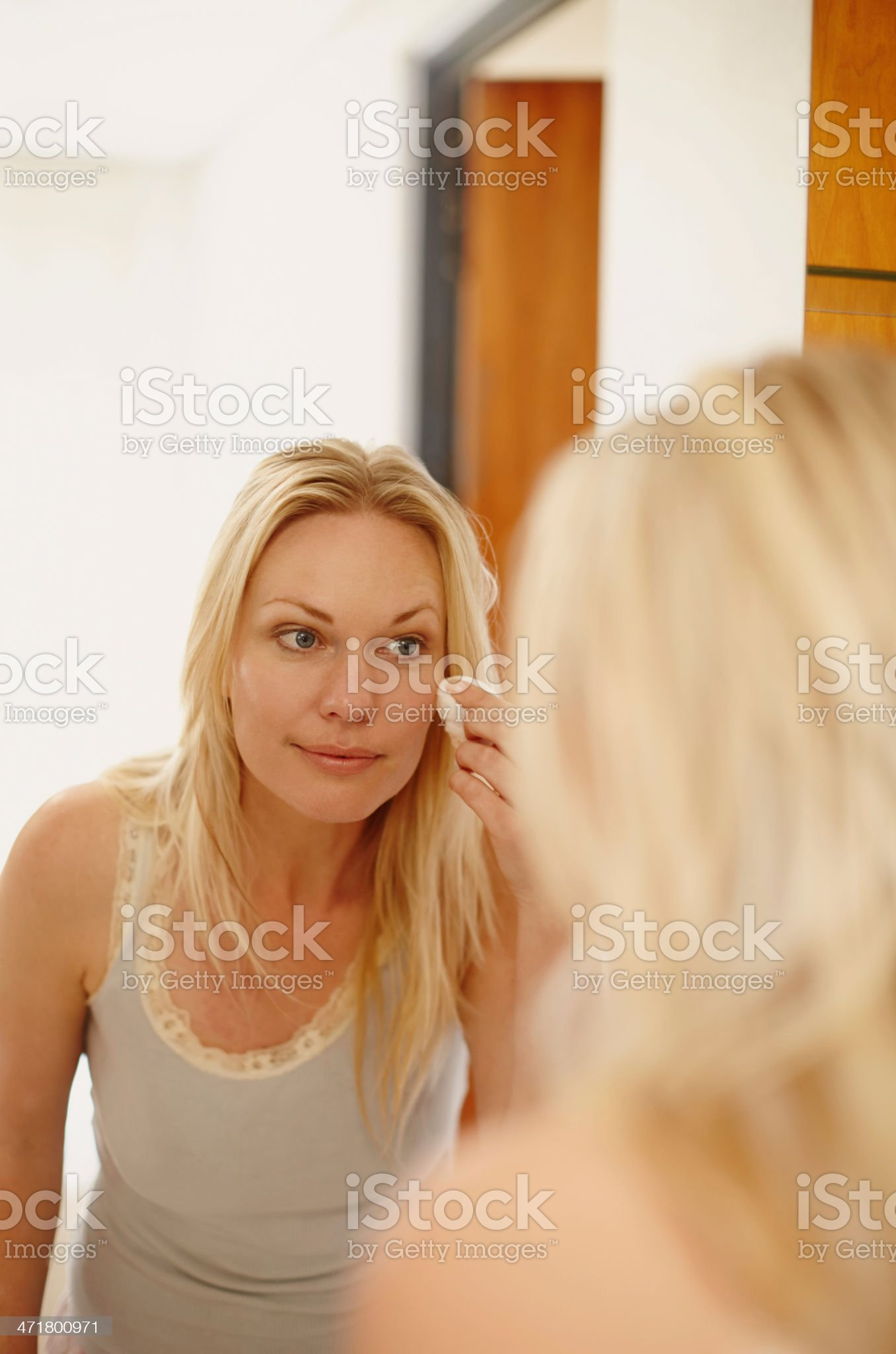 Keeping her skin in great condition royalty-free stock photo