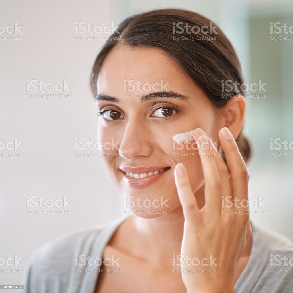 Keeping her skin in perfect condition royalty-free stock photo