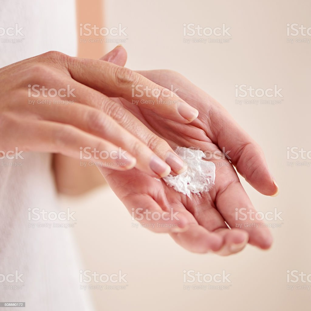 Keeping her skin soft and smooth stock photo