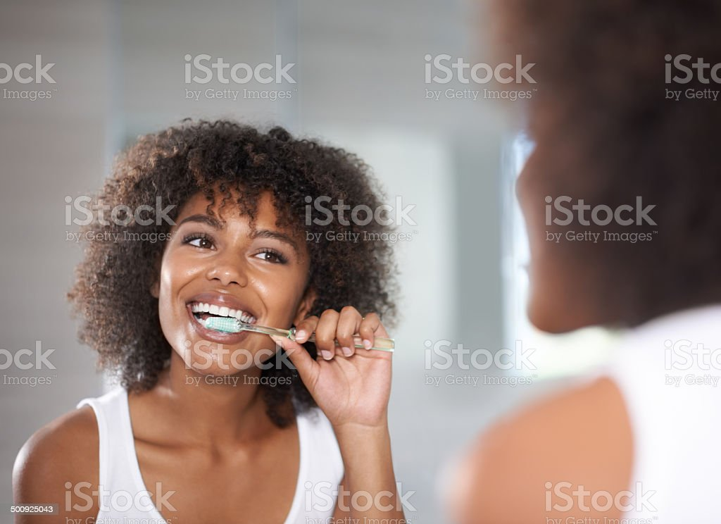 Keeping her smile beautiful stock photo