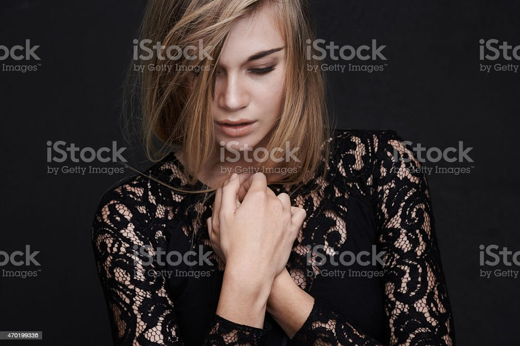 Keeping her style simple in a little black dress stock photo
