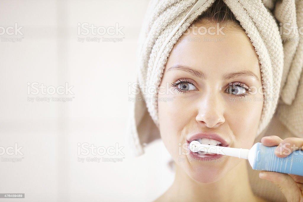 Keeping her teeth in great shape - Dental hygiene stock photo