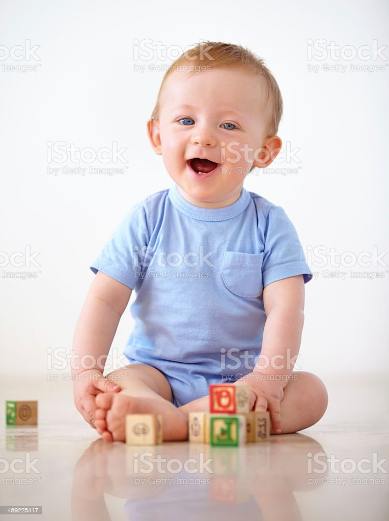 Keeping himself entertained at home royalty-free stock photo
