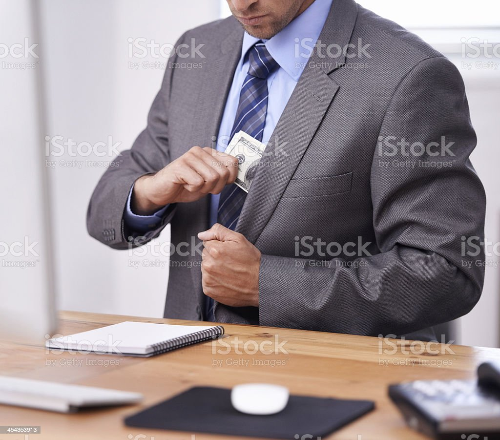 Keeping his assets close to the chest stock photo