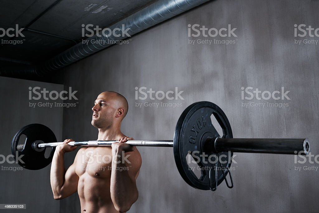 Keeping his focus throughout the workout royalty-free stock photo