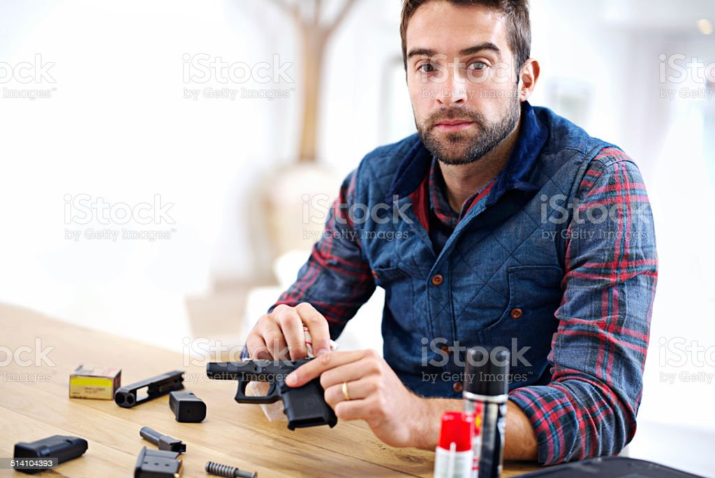 Keeping his gun in good working order stock photo