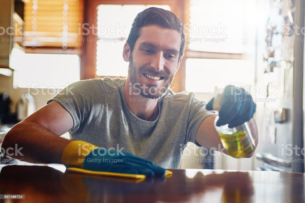 Keeping his home completely spotless stock photo