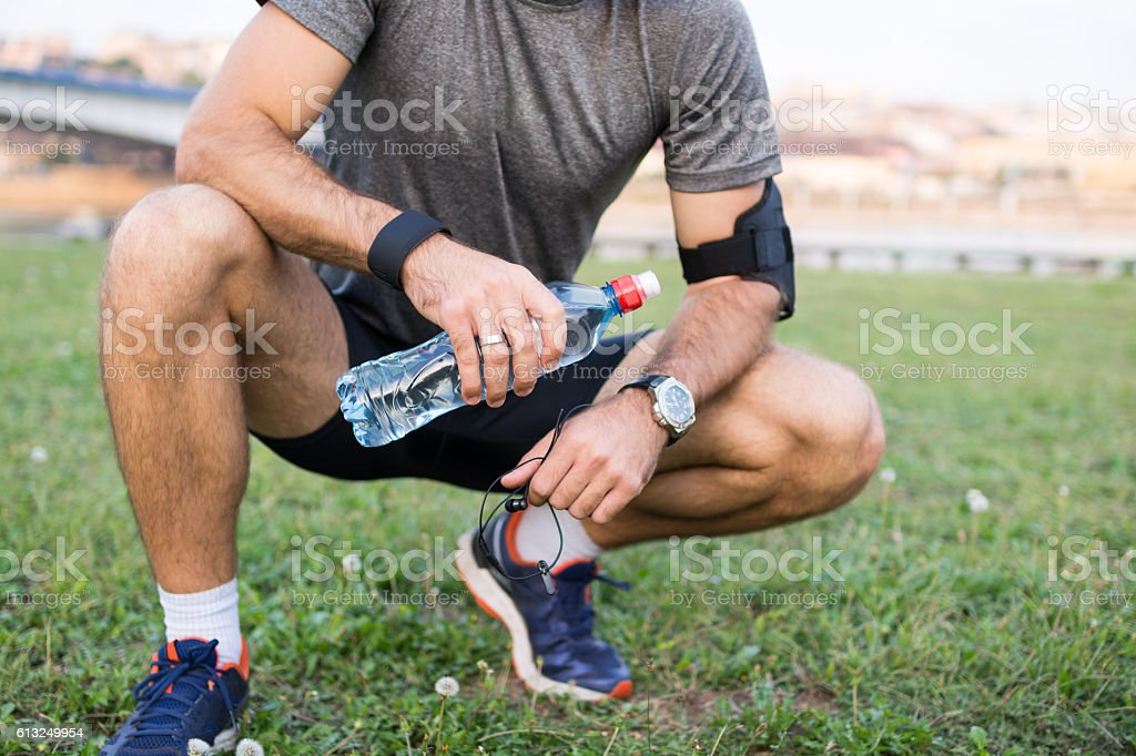 Keeping hydrated through his performance stock photo