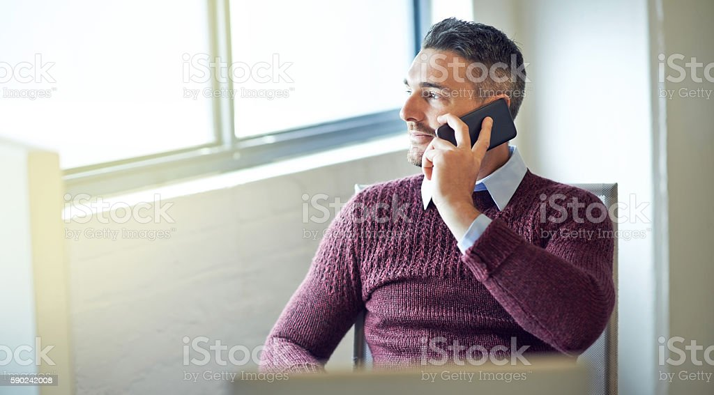 Keeping in touch with his loved ones stock photo
