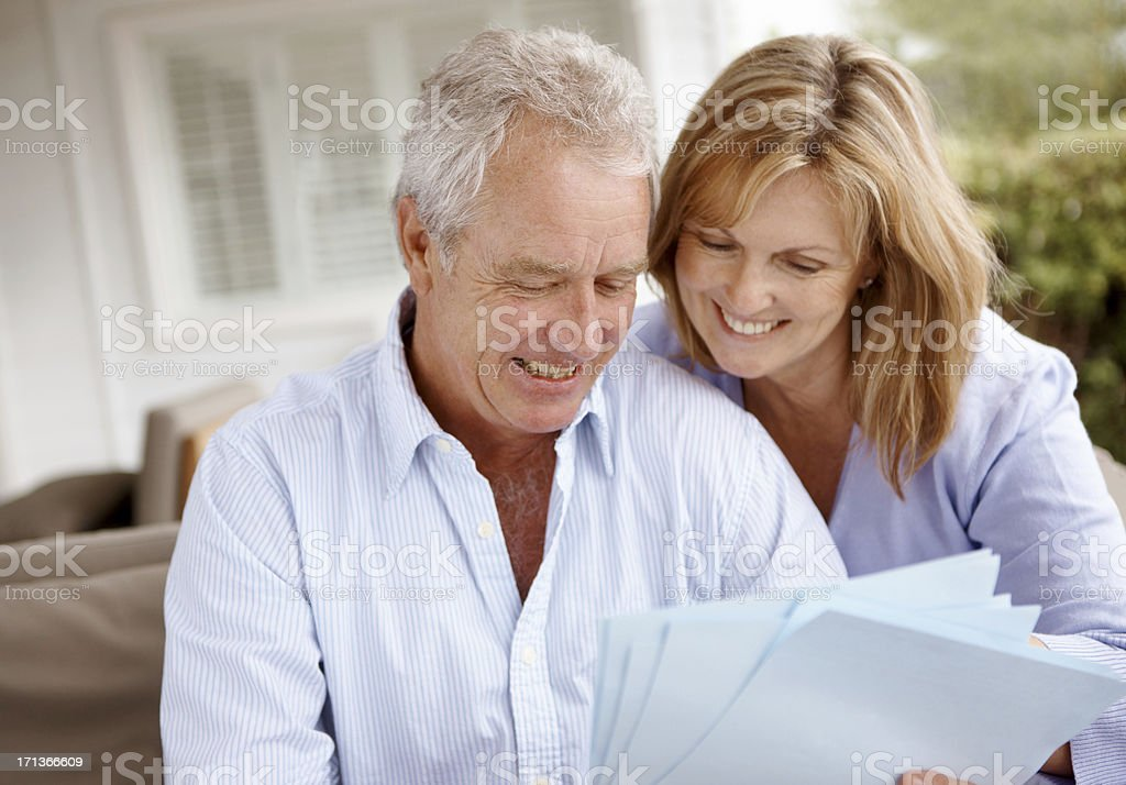 Keeping tabs on their retirement fund royalty-free stock photo