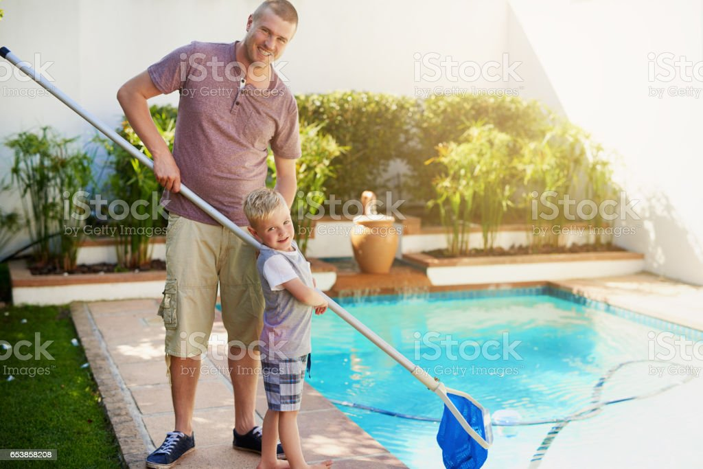 Keeping the pool crystal clear and clean stock photo